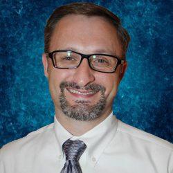 Dr. Chris Rustin